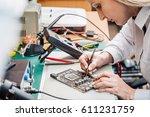 woman repairing computer part... | Shutterstock . vector #611231759