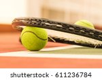 tennis ball with racket on the... | Shutterstock . vector #611236784