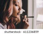 beautiful woman smoking... | Shutterstock . vector #611236859