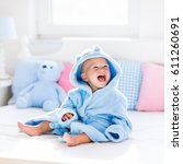 cute happy laughing baby boy in ... | Shutterstock . vector #611260691