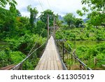 hanging bridge over river in... | Shutterstock . vector #611305019