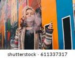 beautiful blonde woman smoking... | Shutterstock . vector #611337317