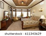 Small photo of Idaho Falls, Idaho, USA Nov. 12, 2014 A luxurious bedroom, with a fireplace and king sized bed, in a modern residence.