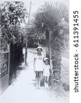 Small photo of USSR, ABKHAZIA, LESELIDZE - CIRCA 1979: Vintage photo of little sister and brother in Abkhazia, USSR