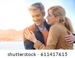 middle aged couple embracing... | Shutterstock . vector #611417615
