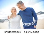 middle aged couple walking... | Shutterstock . vector #611425355