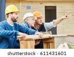 craftsmen working in teamwork... | Shutterstock . vector #611431601