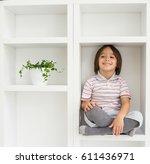 child in shelf inside living... | Shutterstock . vector #611436971