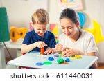kids play modeling plasticine... | Shutterstock . vector #611440031