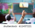 student hands up asking a... | Shutterstock . vector #611457221