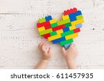 top  view  on child's hands... | Shutterstock . vector #611457935