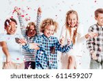 happy kids throwing colorful... | Shutterstock . vector #611459207