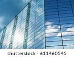 clouds reflected in windows of... | Shutterstock . vector #611460545