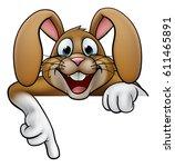 a cartoon rabbit or easter... | Shutterstock .eps vector #611465891
