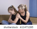 mother worried about unhappy... | Shutterstock . vector #611471285
