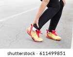 sports injury. woman with pain... | Shutterstock . vector #611499851