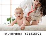 pediatrician doctor examines...   Shutterstock . vector #611516921