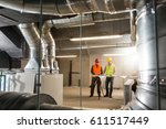 workers making final touches to ... | Shutterstock . vector #611517449