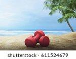 red dumbbells for exercise on... | Shutterstock . vector #611524679
