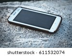 cell phone lying on the rough...   Shutterstock . vector #611532074