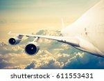 big airliner in the sky   ... | Shutterstock . vector #611553431