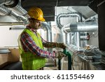 worker making final touches to...   Shutterstock . vector #611554469