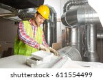 worker making final touches to... | Shutterstock . vector #611554499