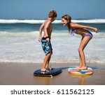 brother and sister playing with ... | Shutterstock . vector #611562125
