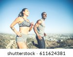 multi ethnic couple training in ... | Shutterstock . vector #611624381