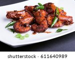 delicious spicy prawns fry. | Shutterstock . vector #611640989