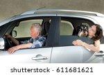 Senior Man Driving Car With Hi...
