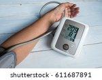 blood pressure gauge show... | Shutterstock . vector #611687891