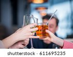 Small photo of Company celebrates victory. Grope of people Clink glasses