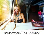 smiling girl sitting on the... | Shutterstock . vector #611703329