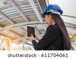 young woman in hardhat with the ... | Shutterstock . vector #611704061