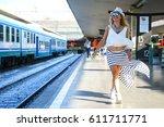 smiling girl walking on a... | Shutterstock . vector #611711771