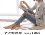 beautiful young woman reading... | Shutterstock . vector #611711801