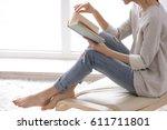 Beautiful Young Woman Reading...