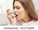 young woman using asthma... | Shutterstock . vector #611711804