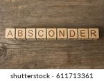 Small photo of absconder word on wooden cubes