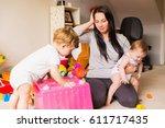 stress mom  with children | Shutterstock . vector #611717435