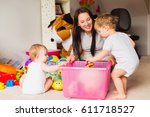 a mother is played with children | Shutterstock . vector #611718527