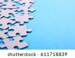 puzzle pieces with empty space... | Shutterstock . vector #611718839