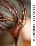 warm chocolate ganache dripping ... | Shutterstock . vector #611727881