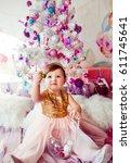 girl in golden dress plays... | Shutterstock . vector #611745641
