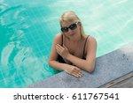 woman relaxing in pool in resort | Shutterstock . vector #611767541
