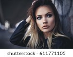 beautiful young blonde with... | Shutterstock . vector #611771105