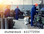 worker in factory on the machine | Shutterstock . vector #611772554