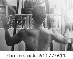 sport man with weight training... | Shutterstock . vector #611772611