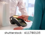 customer paying with...   Shutterstock . vector #611780135